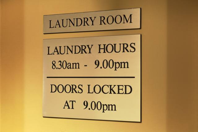 The Macleay Hotel guest Laundry sign in Potts Point