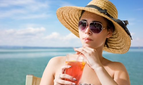 Woman sipping Ice Tea